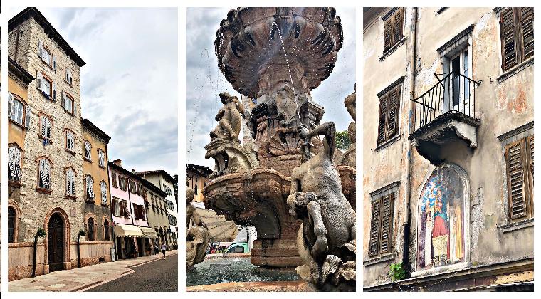 Die Innenstadt von Trient mit seinen alten Häuserfassaden und dem bekannten Neptunbrunnen
